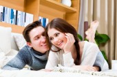 Happy loving couple in a living room — Stock Photo