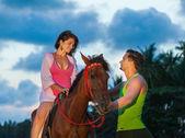 Vacation Lifestyles-Couple Horseback Riding at Sunset — Stock Photo