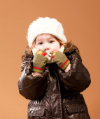 Cute girl in her winter cold weather clothing — Stock Photo