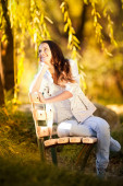 Young woman in the rays of autumn sun — Stock Photo