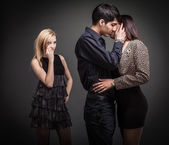 The lonely girl and loving couple — Stock Photo