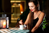 Portrait of young beautiful woman having a coffee — Stock Photo