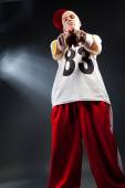 Hip Hop dancer over dark background — Stock Photo