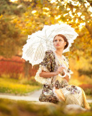 Portrait of a beautiful young woman with umbrella — Stock Photo