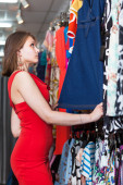 Young woman buying clothes in a boutique — Stock Photo