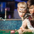 Young woman learning how to play billiard — Stock Photo #57565379