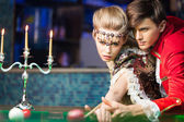 Young woman learning how to play billiard — Stock Photo