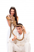 Bride and groom with a hanging rope — Stock Photo
