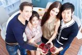 Friends toasting with wine at party — Zdjęcie stockowe