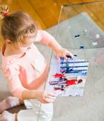 Little child solving a puzzle — Stock Photo