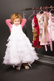 Young girl trying on a white dress — Stock Photo