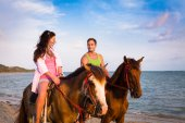 Vacation Lifestyles. Couple Horseback Riding at Sunset — Stock Photo