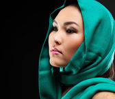 Closeup of beautiful Arabic woman wearing a head scarf — Stock Photo