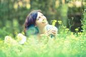 Woman laying on grass — Stock Photo