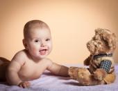 Cute baby girl with Teddy bear — Stock Photo