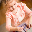 Little child solving a puzzle — Stock Photo #58397823