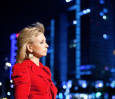 Girl with city nightscape — Stock Photo