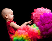 Child with wigs isolated on black background — Stock Photo
