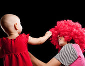 Mother and daughter. isolated on black background — Stock Photo