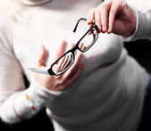 Eye wear in the hands of women — Stock Photo