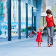 Woman during the shopping with the little girl — Stock Photo #58654531