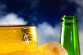 Beer. Clouds background — Stock Photo