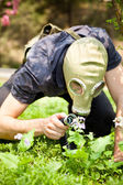 Man in the mask on the flowers background — Stock Photo