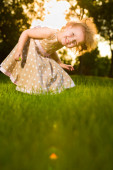 Little girl playing in the forest — Stock Photo
