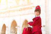 A young girl dressed as a flight attendant sees the sights — Stock Photo