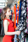 Young woman buying clothes in a boutique — Стоковое фото