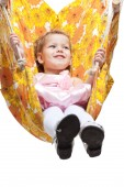 A young girl smiling on a swing. isolated on white — Stock Photo