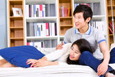 Loving young couple lying down on the bed — Foto de Stock