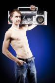 Youth culture. men with old tape recorder — Stock Photo