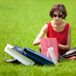 Woman resting on the lawn after shopping — Stock Photo #59496601