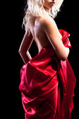 Back of the woman in red. isolated on black background — Stock Photo