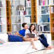 Young couple using digital tablet — Stock Photo #59729583