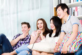Friends singing karaoke at party — Stock Photo