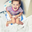 Little girl with a roll of toilet paper — Stock Photo #59733647