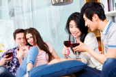 Friends toasting with wine at party — Stock Photo