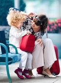 Mom and daughter with red bags — Stock Photo