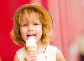 Smiling girl holding her ice cream — Stock Photo