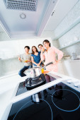 Group of people in the kitchen — Stock Photo