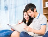 Young couple reading a book — Stock Photo