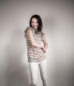 Asian girl. Gray background — Zdjęcie stockowe