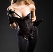 Young female dressed in corset — Stock Photo