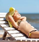 Picture of one lovely little girl in a swimsuit — Stock Photo