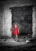 Neglected little girl in the middle of demolished building — Stock Photo