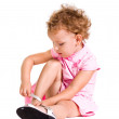 Funny little blonde girl in pink dress with pair of new shoes — Stock Photo #59933043