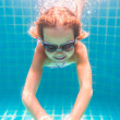 Girl smiles, swimming under water in the pool — Stock Photo #67205155