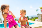 Two adorable children eating yoghurt — Stock Photo